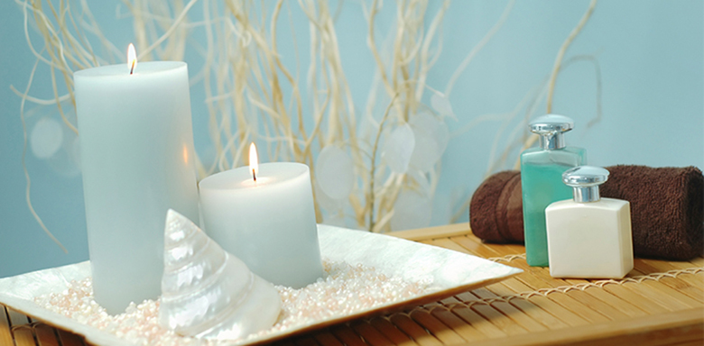 Teal candles 3 | Serenity Massage + Wellness Spa